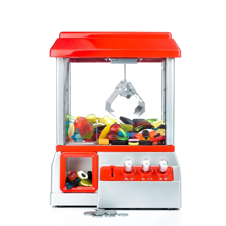 La machine à pince de fête foraine, attrape bonbons et jouets